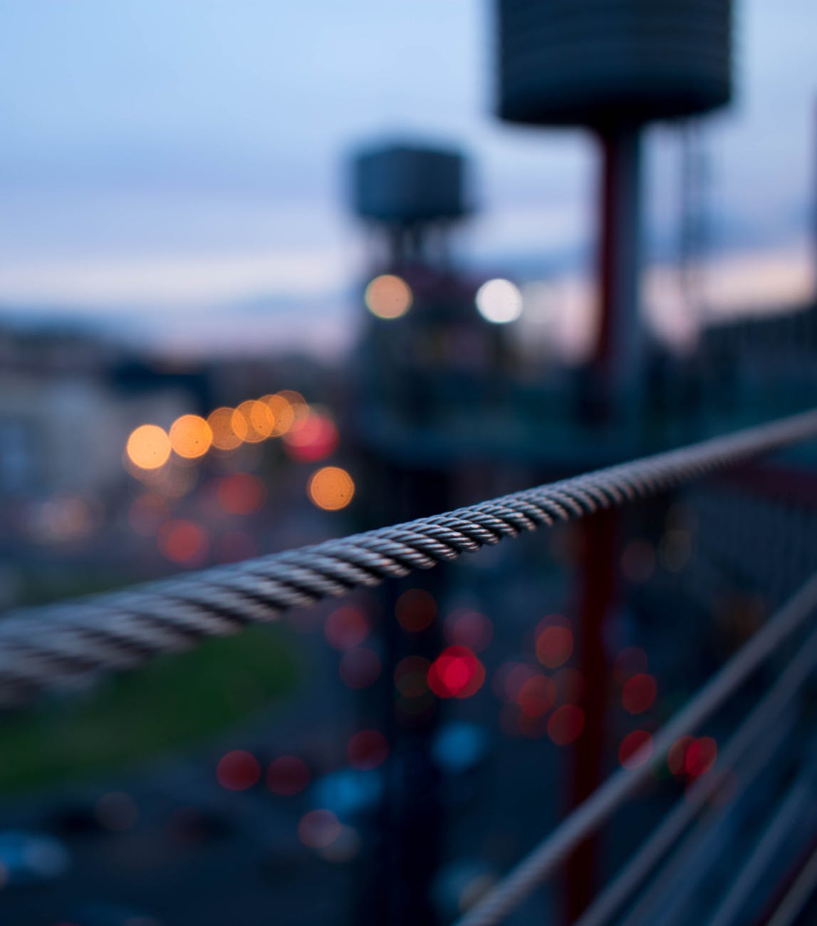 selective focus photography of grey wire