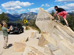Climbing up rock at Estes Park