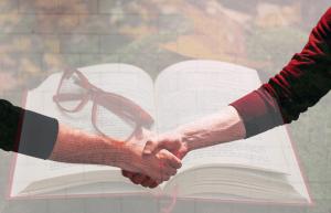 Handshake over Book