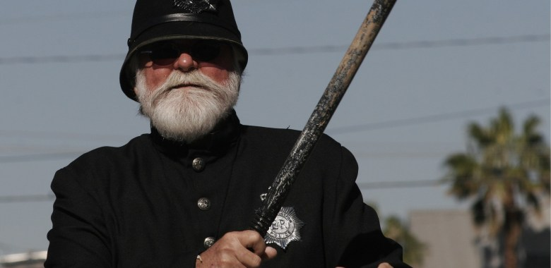 Old time police in uniform with nightstick