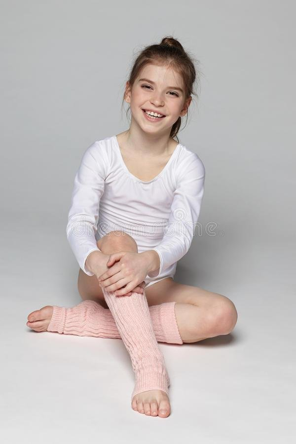 Best Laughing Little Girl Wearing Sport Clothing Sitting On The With Pictures