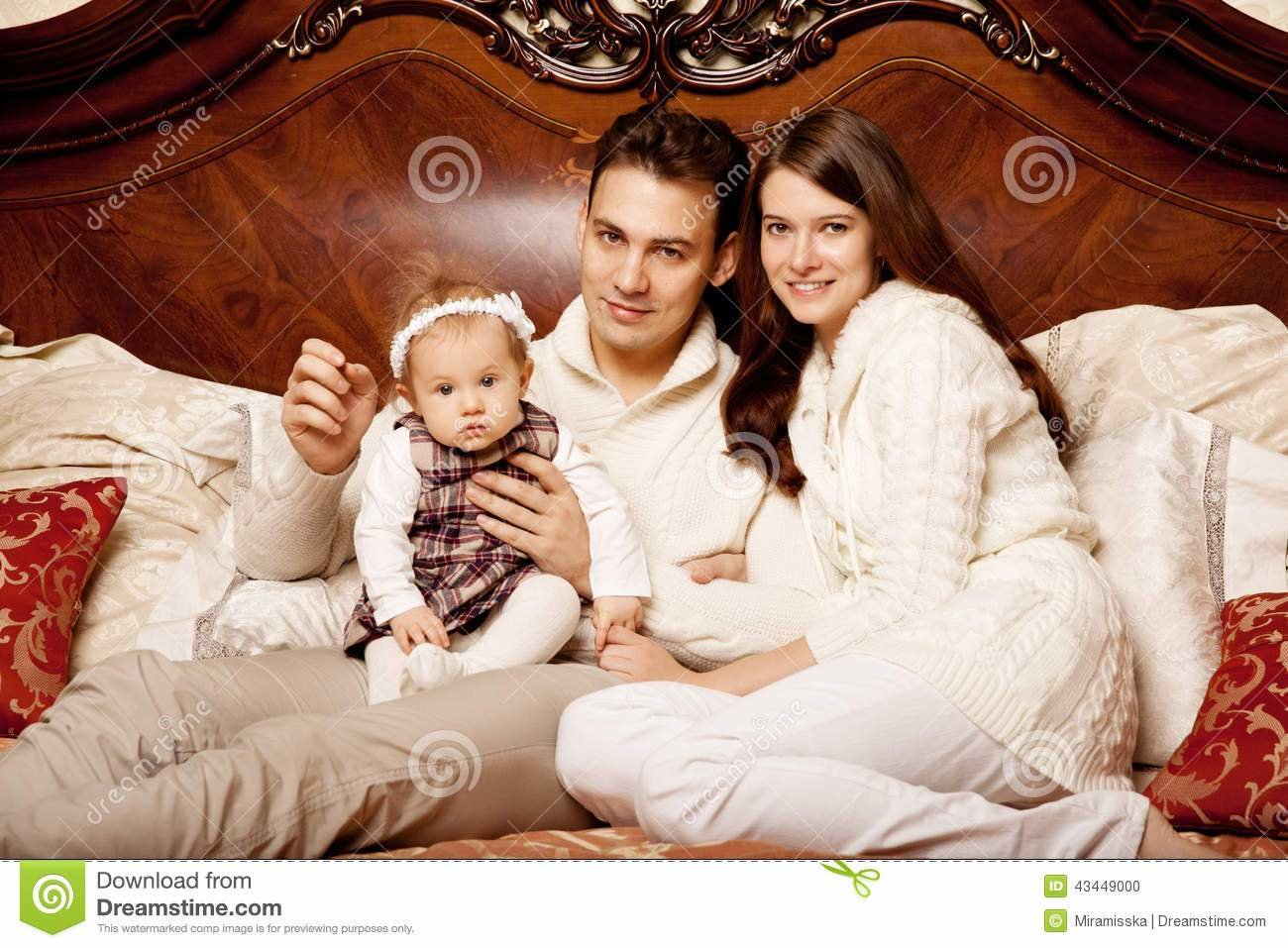 Best Cute Family In The Bedroom Mother Father And Daughter In With Pictures
