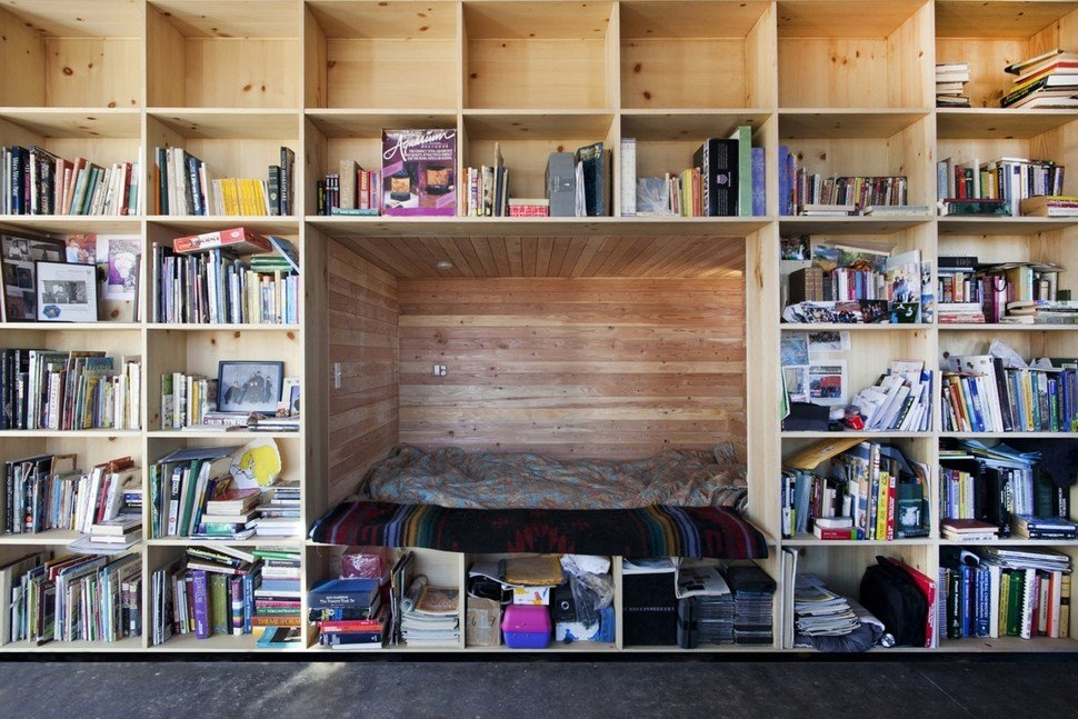 Best Nakai House In Utah Features Wall Of Shelves With Bedroom With Pictures