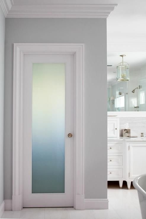 Best Fantastic Bathroom Boasts A Frosted Glass Water Closet Door Accented With A Brass Door Kn*B With Pictures