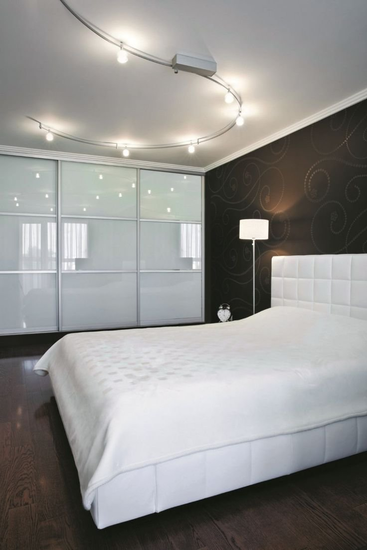Best Minimalist Modern Bedroom With Track Lighting Fixtures Over The Bed With White Bedding With Pictures