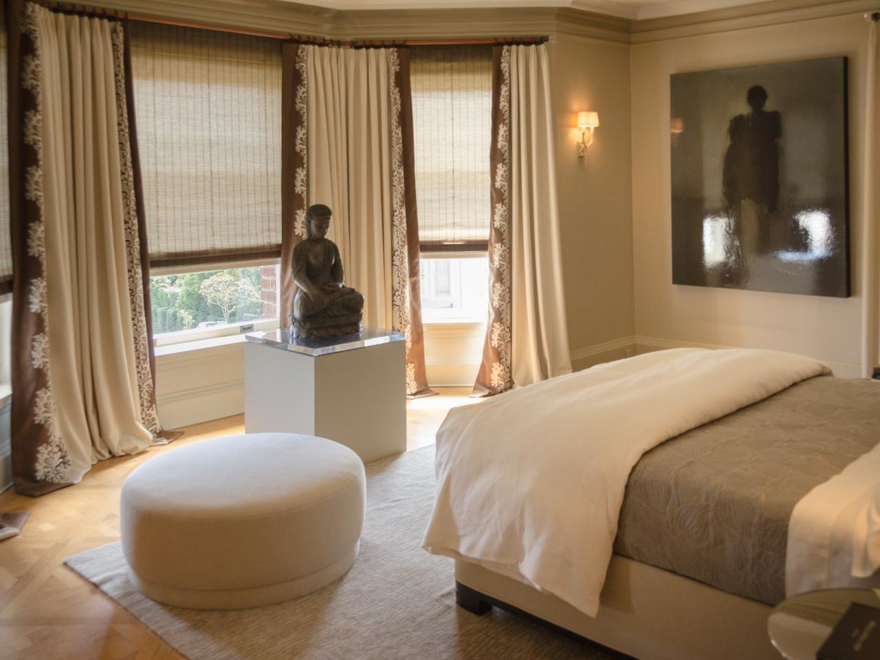 Best Stone Buddha Is Centerpiece Of Neutral Bedroom Hgtv With Pictures