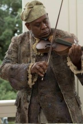 Forest Whitaker as the Fiddler in Roots (2016).