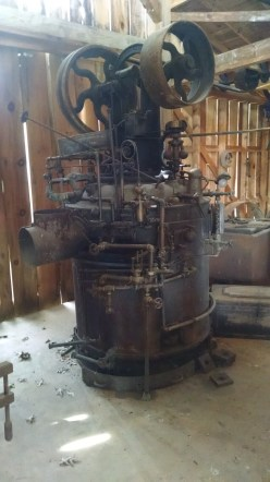 We saw a steam engine. An engine like this could run a whole shop from those big flywheels.