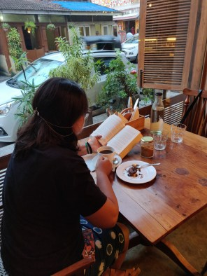 Birdsong Café allows patrons to sit in a relatively quiet corner with a book as the city rushes past them.