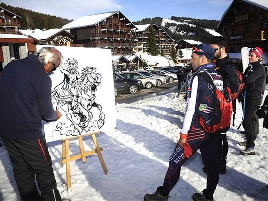 Inauguration du 21 ieme festival BD, Les Saisies. Philippe Luguy, après avoir dessiné en public explique à des vacanciers des Saisies son travail.