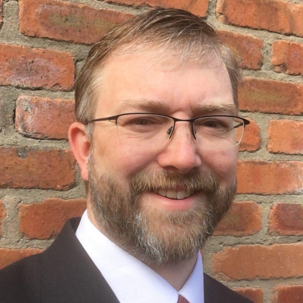 Dr. David G. Whitla
