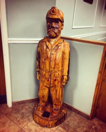 Carved coal miner