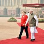 NEW DELHI, INDIA – NOVEMBER 1: Prime Minister Narendra Modi with German Chancellor Angela Merkel during the ceremonial
