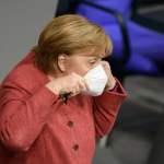 Berlin,,2020-12-09:,Angela,Merkel,Puts,On,Her,Mask,At,The