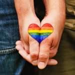 Rainbow,Heart,Drawing,On,Hands,,Lgbtq,Love,Symbol,,Gay,Couple