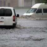 Car,Rides,In,Heavy,Rain,On,A,Flooded,Road