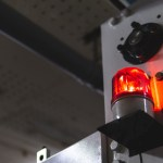 Blurred,Low,Key,Illuminated,Factory,Industry,Red,Alert,Emergency,Light