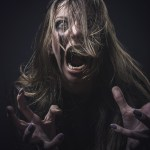 Crazy,Deranged,Woman,Pulling,Her,Hair,Out,,Scary,And,Insane,