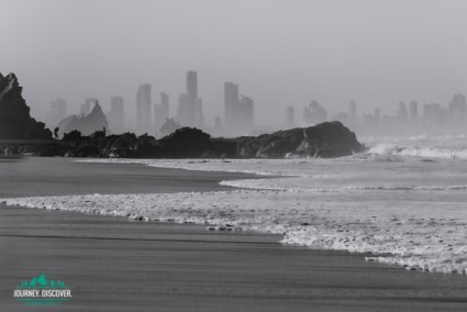 Currumbin Rock and Elephant Rock in front of the Gold Coast skyline.