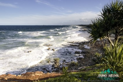 Point Arkwright, Sunshine Coast, Queensland, Australia  Ocean waves with tree on right