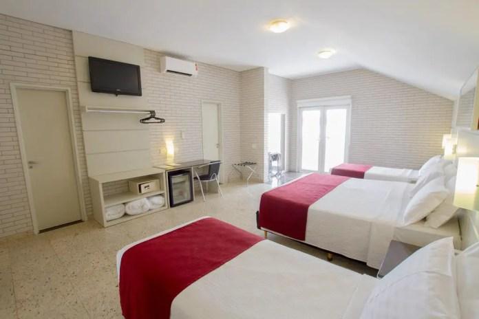Triple room in the Curitiba hotel of Hotel Confiance Soho Batel