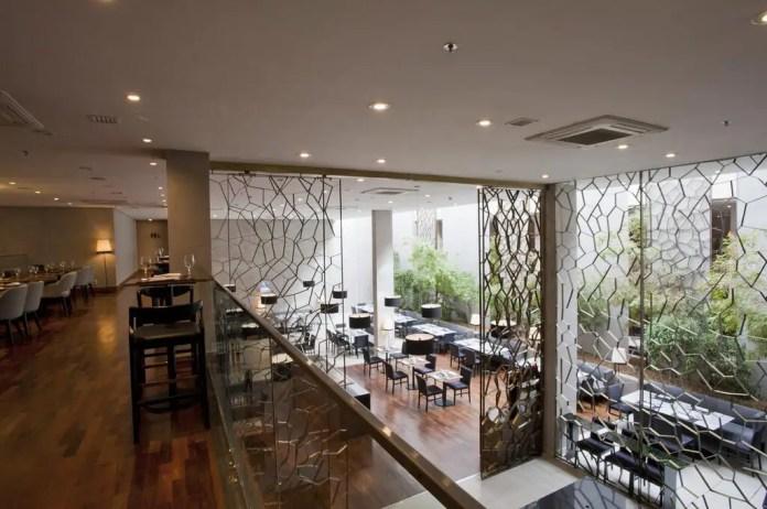 Terrace area of NH Curitiba the Five, overlooking alfresco garden dining space
