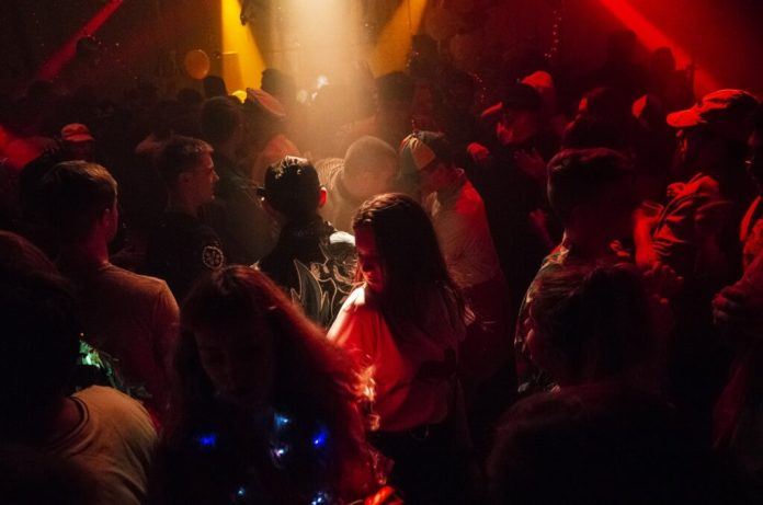 A crowd of people gathered in one of the best and most exciting night clubs in San Jose called ENSO Bar and Grill