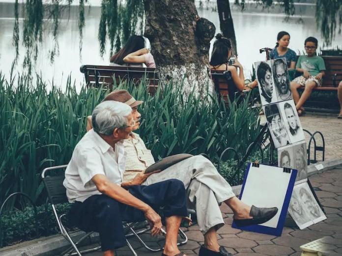 Vietnam people sitting on bench