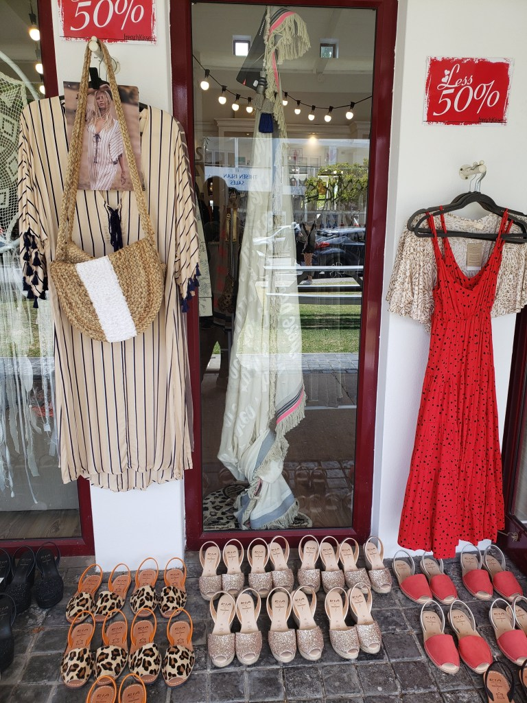 storefront with unique dresses, shoes and bags