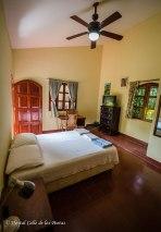 Room 3 w/ private bathroom. Spacious room w/ closet, desk, TV, window to the patio. Price: 1 person $ 22 per night 2 persons $ 30 per night