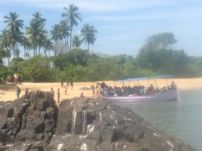 Boatloads of tourists (mostly from Bangalore) at St Mary's Island, off Malpe Beach.