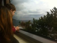 Mum and P take in the Shimoda coastline from their seats on the panorama view train, Shizuoka, Japan.