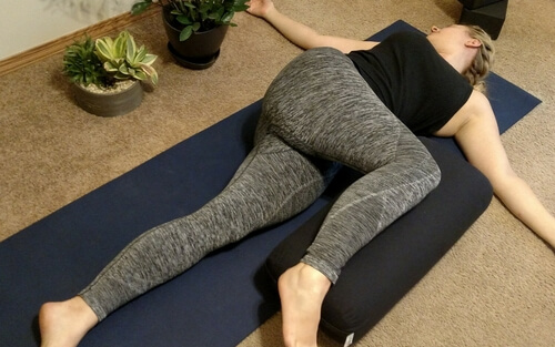 Using yoga bolsters for supported reclining twists