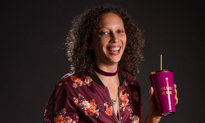 Molly smiling with a cup