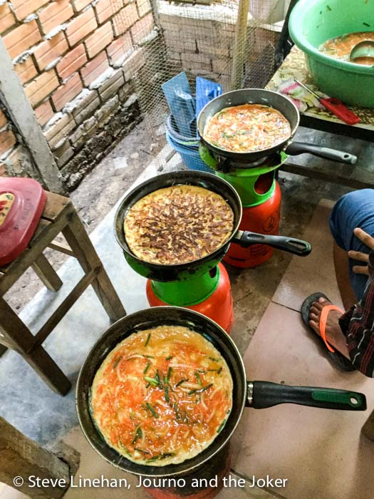 Cooking omelettes at Touch A Life, Siem Reap