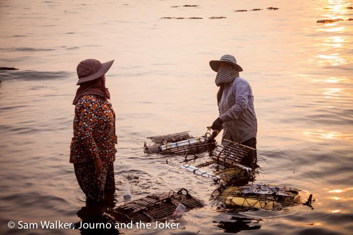 Women with crab pots at crab market at Kep