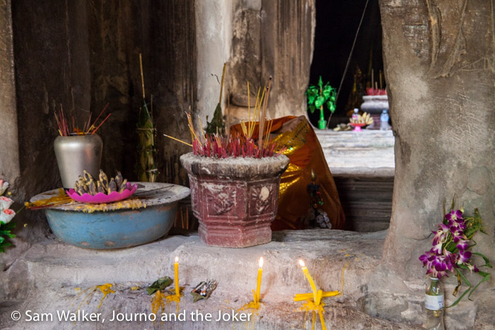 Offerings to the gods in the ancient temple at Wat Atvea