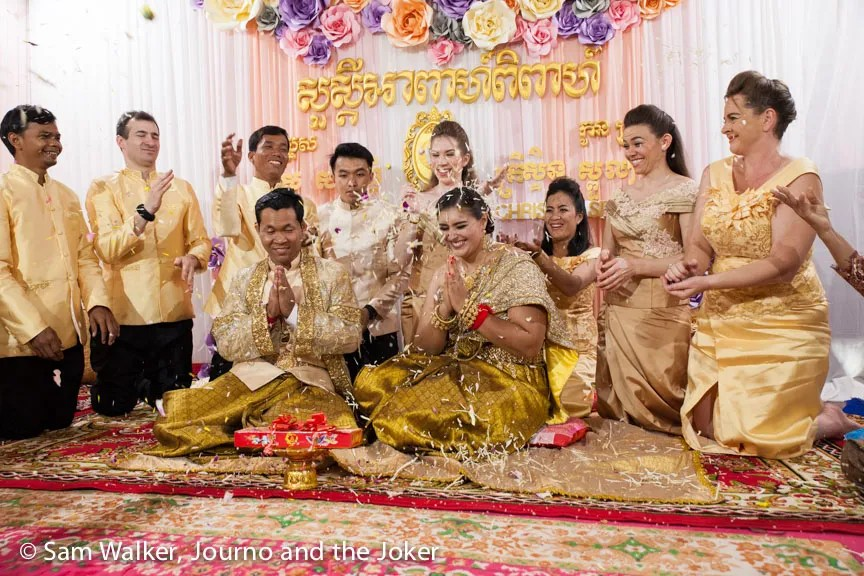 Throwing palm flowers at a Cambodian wedding