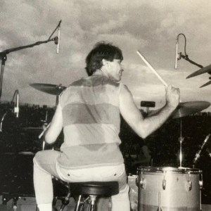 Charlie Watts on stage by Jo Wood