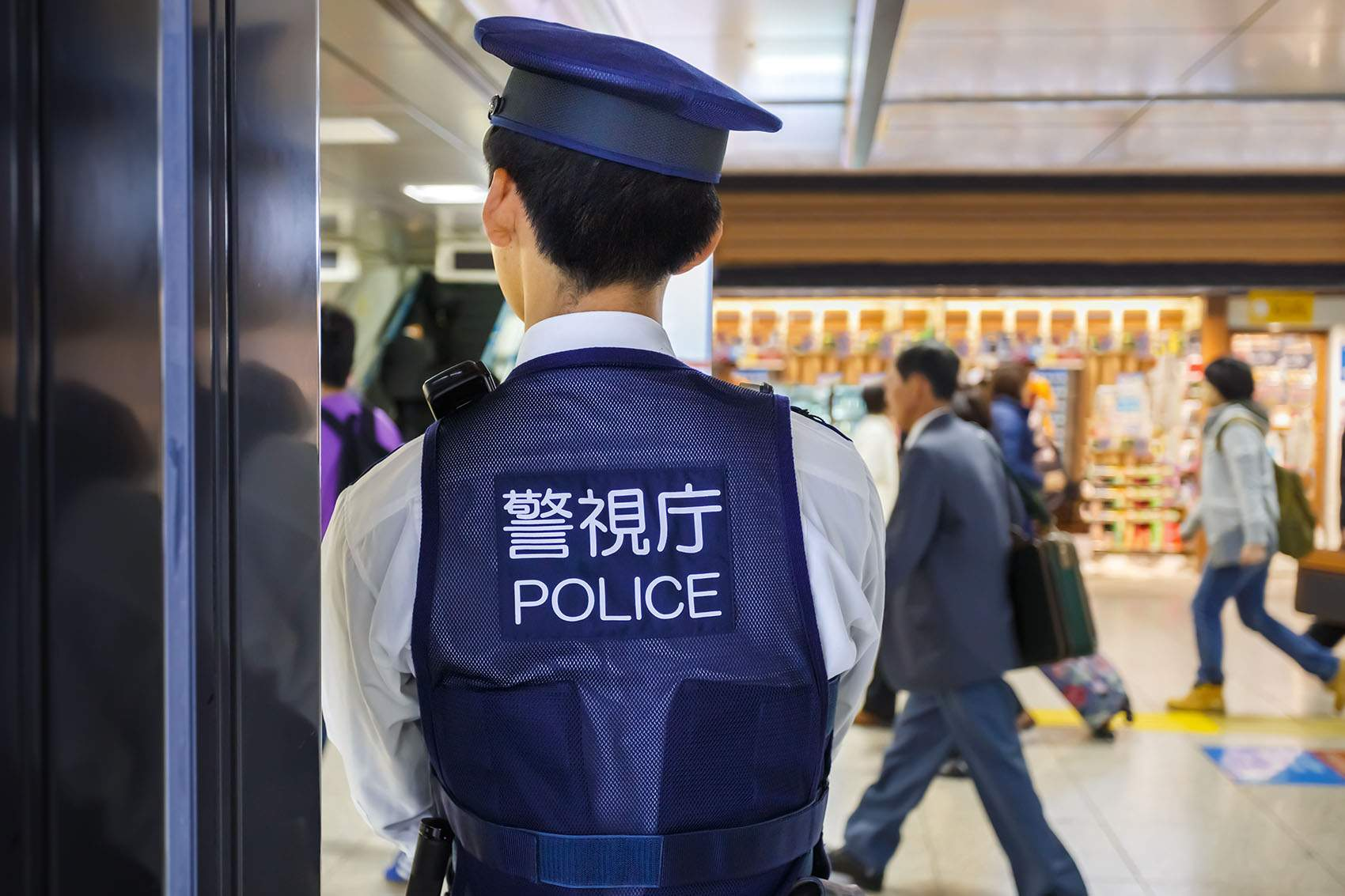 TOKYO, JAPAN - NOVEMBER 26: Policeman in Tokyo, Japan on November 26, 2013. Tokyo station provides maximun security by placing policemen in many areas of the station