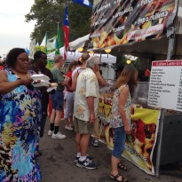 People were enjoying the Latino food, merchandise, and the music!