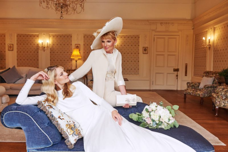 Bride and mother staring at each other at Sorn Castle both wearing couture Joyce Young.