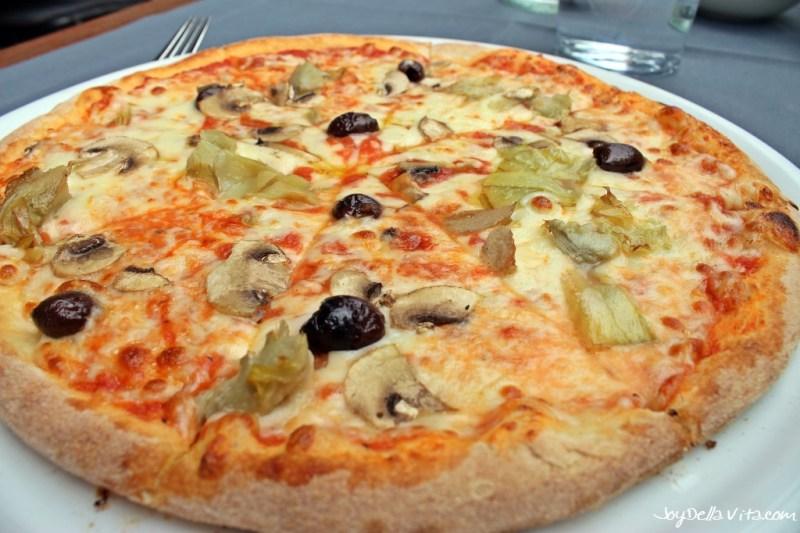 PIZZA FOUR SEASONS with Tomato, mozzarella, olives, artichokes, mushrooms Maio Restaurant la Rinascente Milano JoyDellaVita