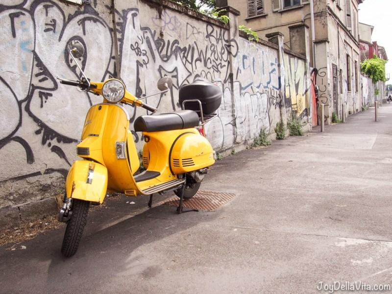 vintage yellow Vespa in Navigli Milan