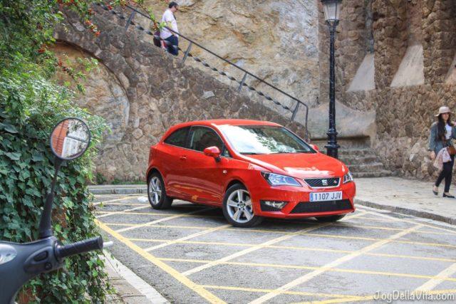 red SEAT Ibiza near Park Güell