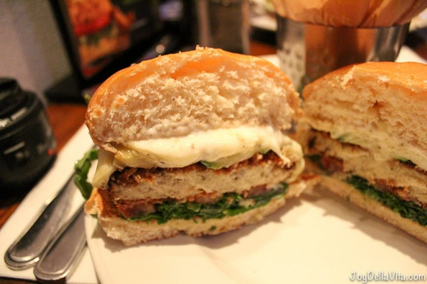 Veggie Cauliflower Burger - toasted bun, with a house-made patty out of cauliflower, garlic, egg, goat cheese, oregano, and breadcrumbs, topped with grilled zucchini, squash and Monterrey Jack Cheese with arugula, tomato and garlic aioli.