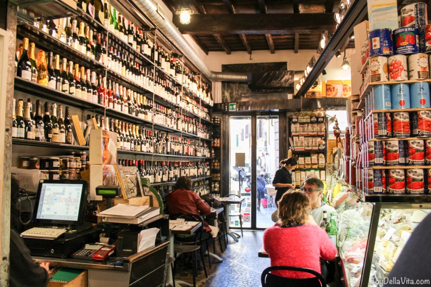 Outstanding Location, eating in the middle of a Deli Store in Rome