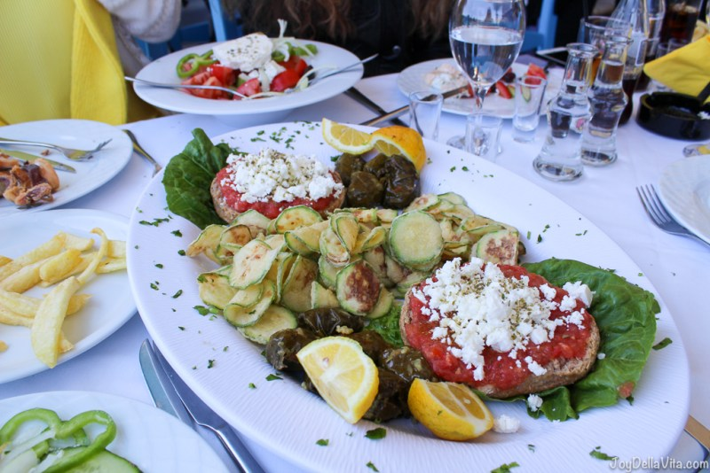 Meat-free vegetarian plate with 2 Dakos, fried Zucchini and Dolmades (tender vine leaves stuffed with rice and fresh herbs) Crete Greece JoyDellaVita