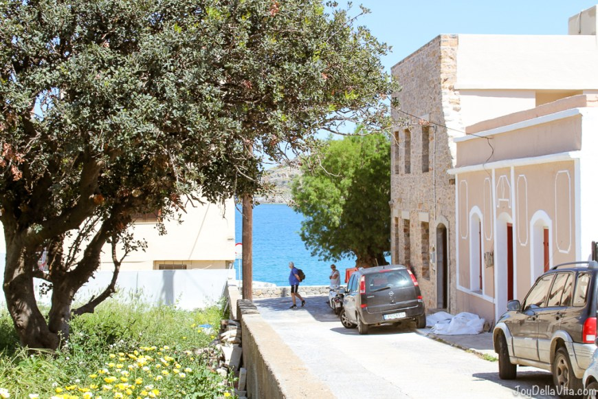 Strolling around Plaka in north-eastern Crete, with a view of  Spinalonga Island during Land Rover Experience Greece -  JoyDellaVita.com