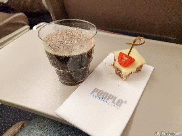 In-Flight snacks by People's Viennaline: Drink of choice and slice of bread with either cheese or cold-cuts -- People's Viennaline Flight Review Embraer 170 - Travelblog JoyDellaVita.com